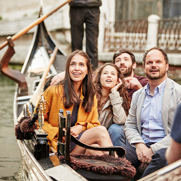 group of friends smiling in Venetian gondola