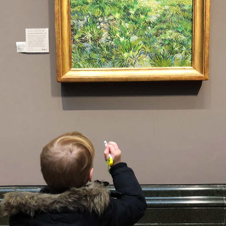 child looks at art in london gallery