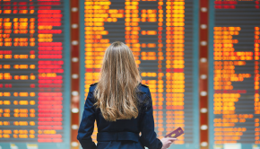 Woman travelling for business checking the departures screen