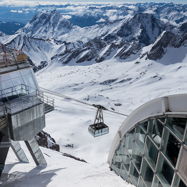Cable car over snow-covered peaks of the German Alps