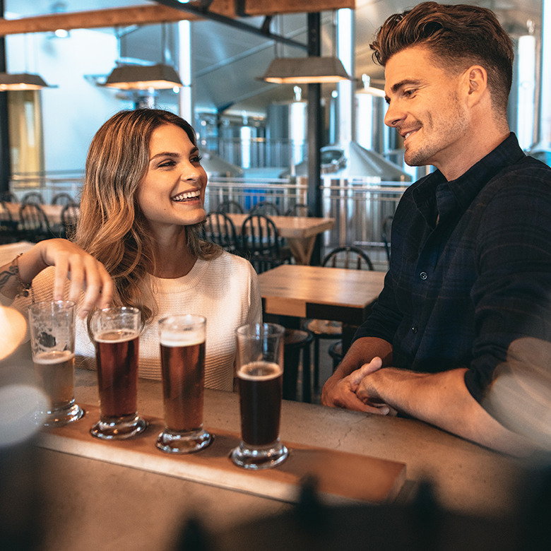 Group enjoying a flight of beer at a brewery