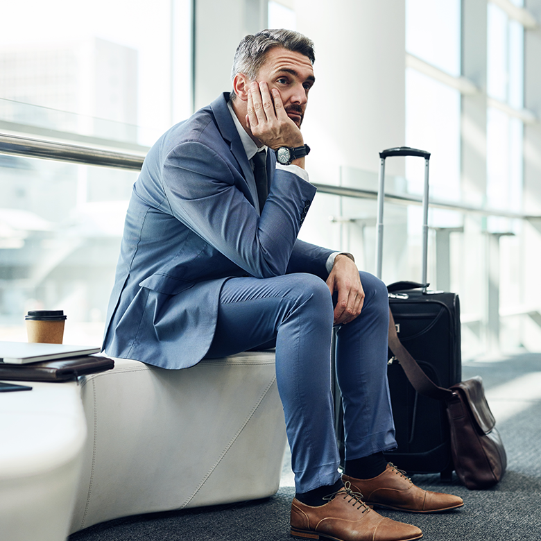 Frustrated business traveller impatiently waiting for flight