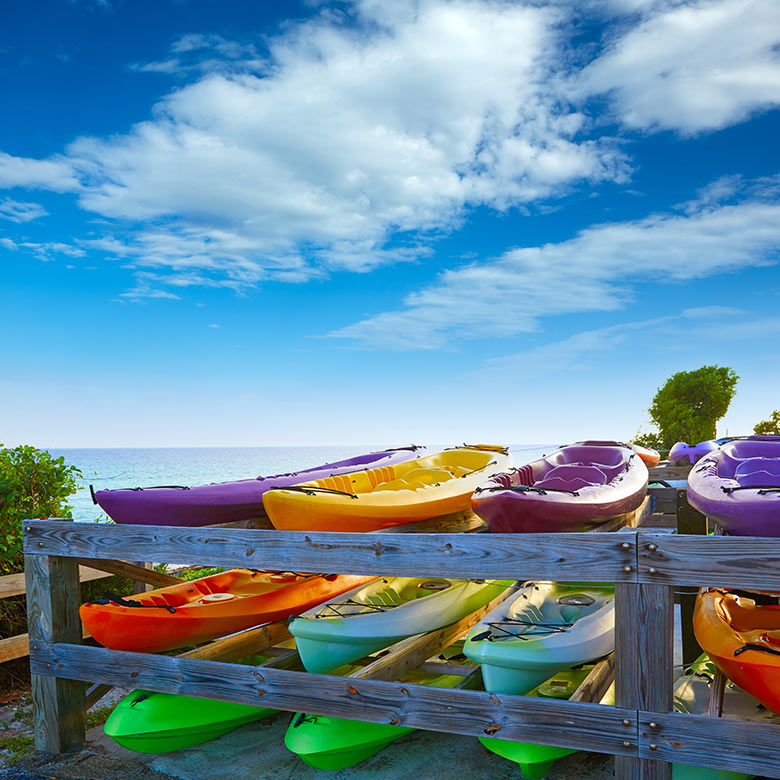 colourful kayaks line the beach in florida key west