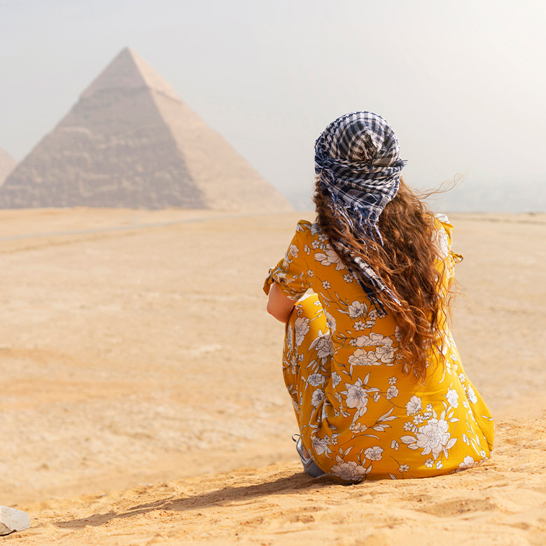 woman visiting the pyramids in giza, egypt