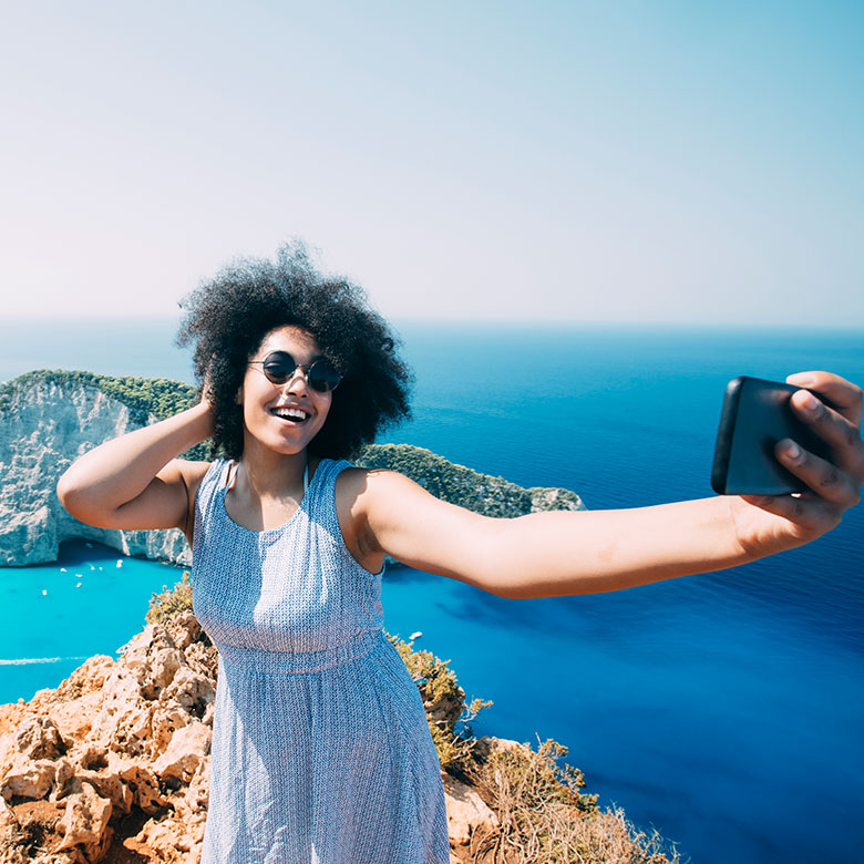 woman taking a selfie in greece