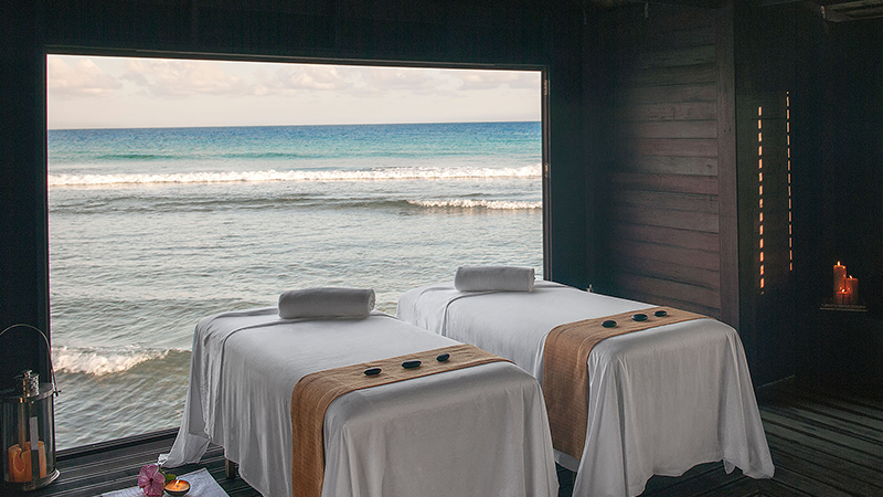 couples massage tables on beach at half moon