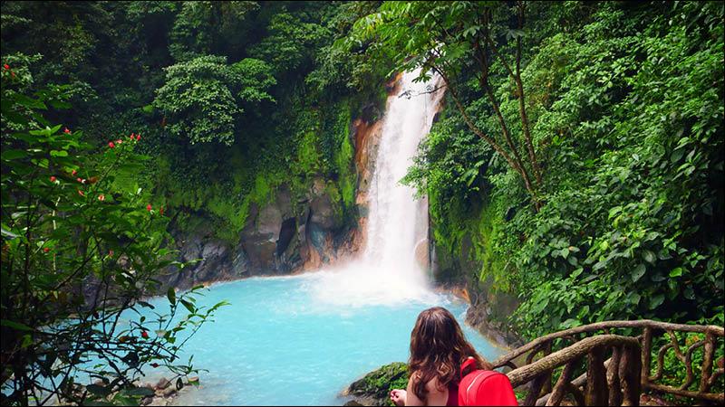 traveller hiking to waterfall in costa rica