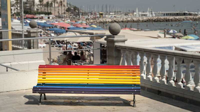 rainbow painted bench overlooking gay beach in sitges spain