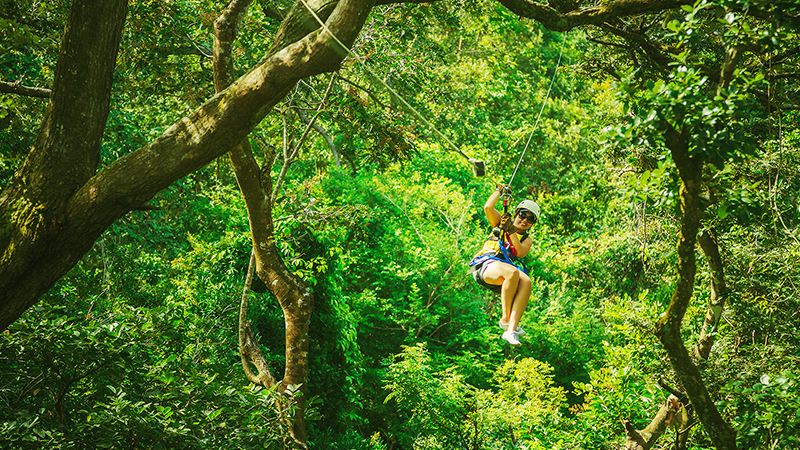 woman ziplining at mystic mountain montego bay